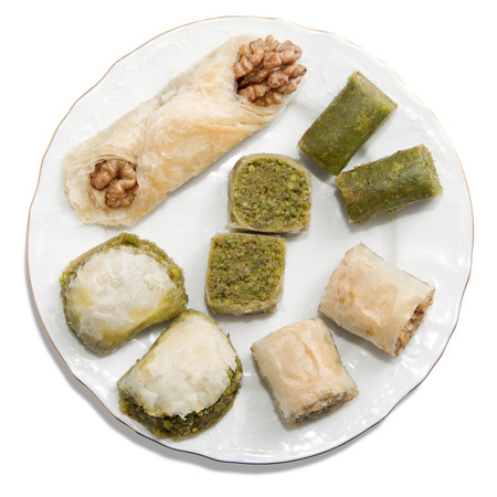 Plate with turkish baklava isolated over white background photo
