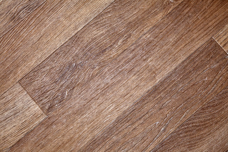 woodgrain: Close-up of new linoleum with parquet pattern, background