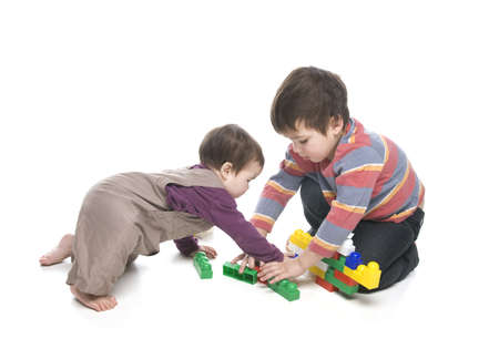Brother and sister playing together over white background Stock Photo