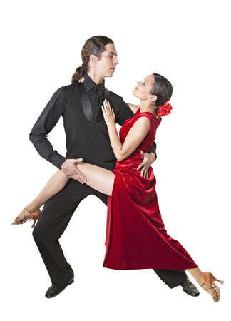 Young couple dancing tango isolated over white
