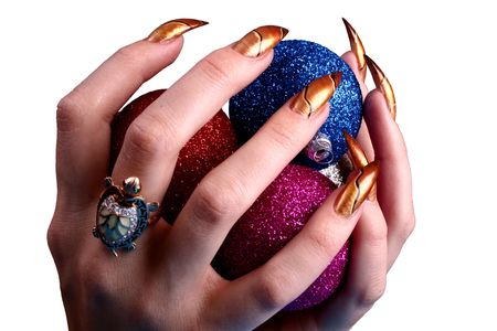 christmas manicure: Celebratory ornaments for itself and for a fur-tree. Stock Photo