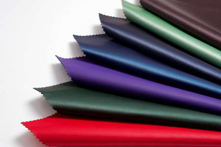 prompt: Stocks of a fabric are necessary for manufacture of a garment factory