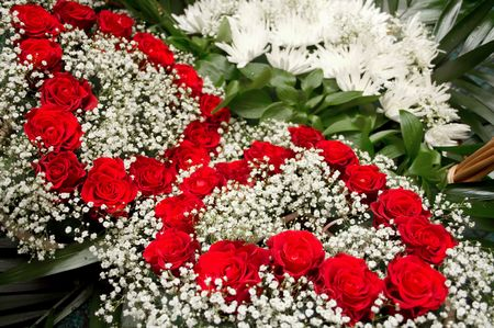 floristics: Hearts from red roses are laid out in a congratulatory basket