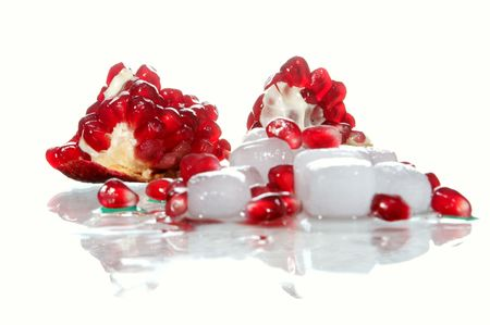Berries of the broken pomegranate on glass photo