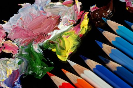 daubs: Mixing of an oil paint on black glass. Stock Photo