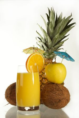 Fresh juice from an orange and ripe pineapple on a white background. photo