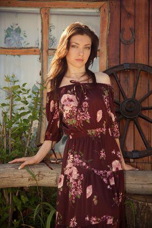 Beautiful rural girl near the dwelling. Stock Photo - 4964427