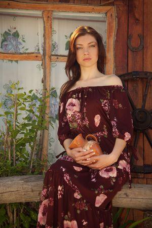Beautiful rural girl near the dwelling. Stock Photo - 4964426