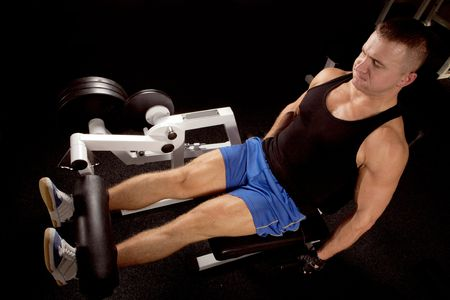 Man makes exercises for increase in force of muscles Stock Photo
