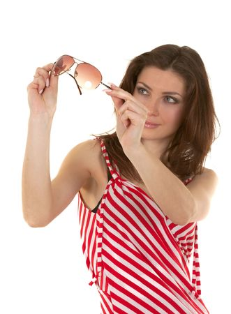 Brunette in a red striped dress with sunglasses photo