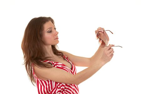 Brunette in a red striped dress with sunglasses Stock Photo - 6679401