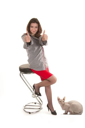 Girl to a red skirt among cats on a white background photo