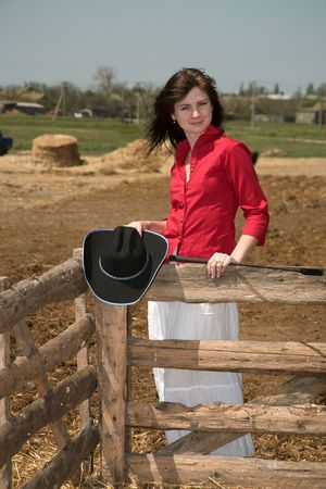 Portrait of the beautiful girl on a background of a farm photo