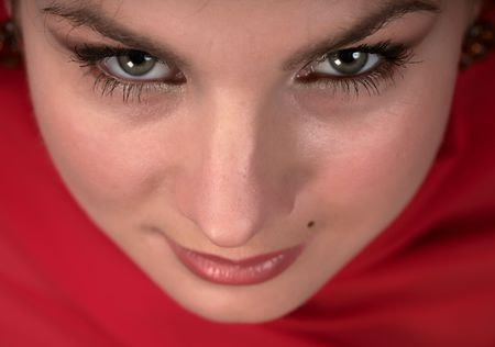 Portrait of east woman in a red scarf Stock Photo - 7073992