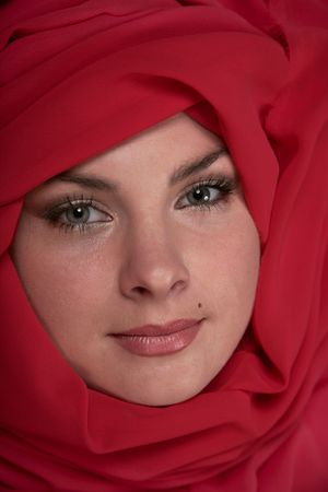 Portrait of east woman in a red scarf Stock Photo - 7073991