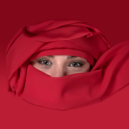Portrait of east woman in a red scarf Stock Photo - 7074003