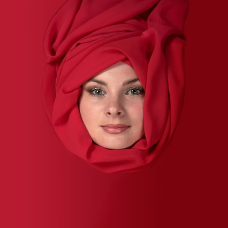 Portrait of east woman in a red scarf Stock Photo - 7074005