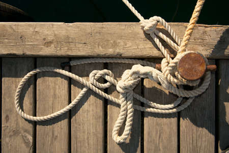the mooring: Rope for mooring a vessel is adhered to a pier