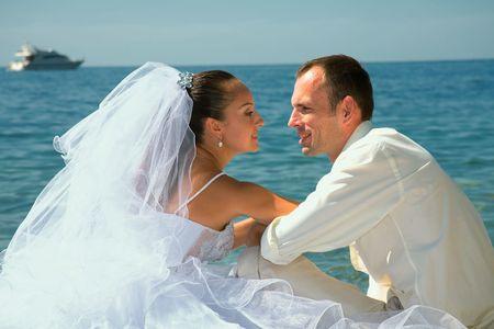 Happy married couple. Photosession on coast of the black sea. photo