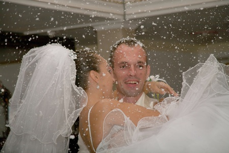 winter wedding: Happy married couple. The first snow falls. Stock Photo