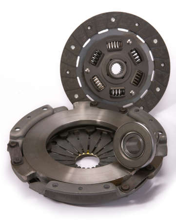 clutch: Spare parts of motor vehicle forming clutch plate and disc. Stock Photo