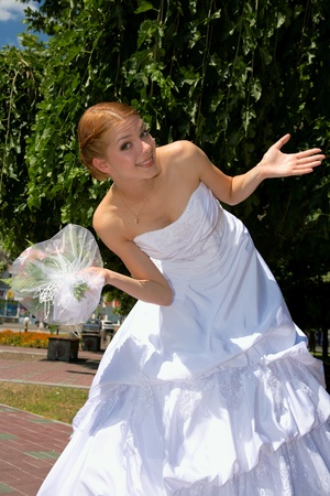 Happy bride with pleasure poses for the photographer. Stock Photo - 10382975
