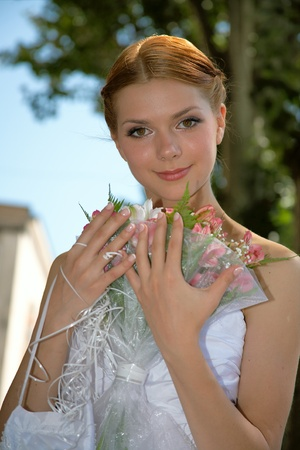 Happy bride with pleasure poses for the photographer. Stock Photo - 10382972
