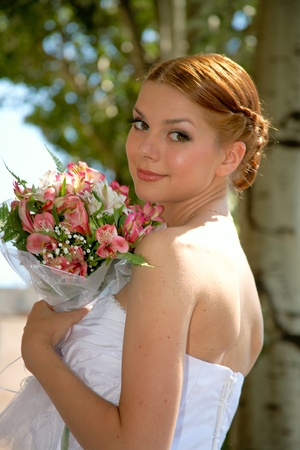 Happy bride with pleasure poses for the photographer. Stock Photo - 10382973