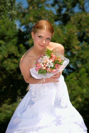 Happy bride with pleasure poses for the photographer. Stock Photo - 10382968