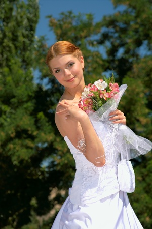 Happy bride with pleasure poses for the photographer. Stock Photo - 10382974