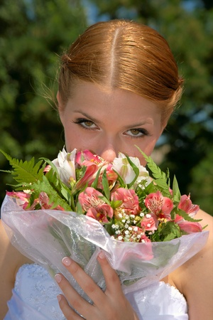 Happy bride with pleasure poses for the photographer. Stock Photo - 10382976