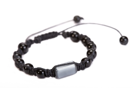 Popular Buddhist bracelet shamballa on a white background. Stock Photo - 12976584