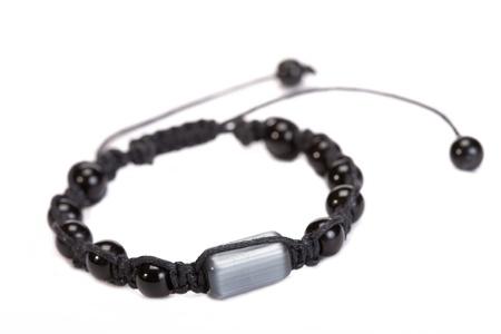 Popular Buddhist bracelet shamballa on a white background. Stock Photo - 12976584