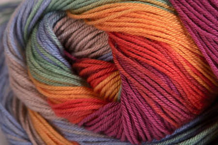 descriptive colour: Ball of a color wool yarn for needlework