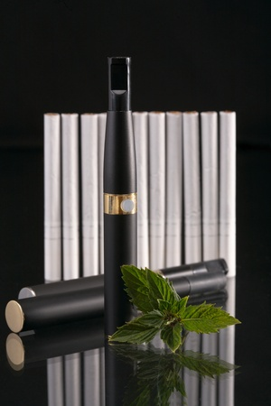 Set for smoking. The electronic cigarette has the big popularity at interested persons to not smoke. photo