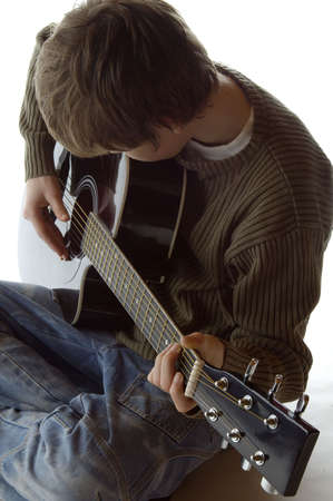 fret: Playing the guitar Stock Photo