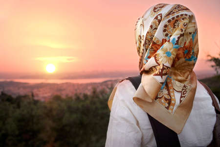 muslim: Muslim women and sunset. Muslim women fashion style. Stock Photo