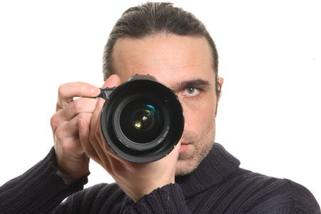 The man looks in a camera photo