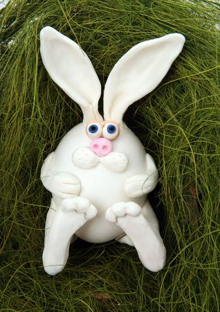 nouse: The rabbit made of egg, lays in a nest from a grass