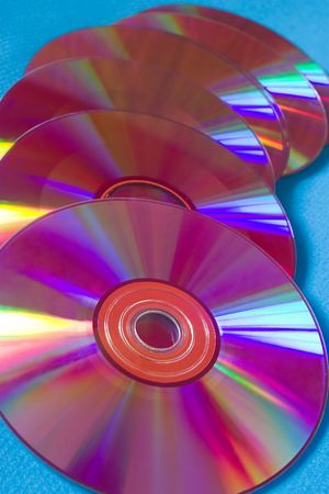 optical disk: Six pink cd-disks on a blue background Stock Photo