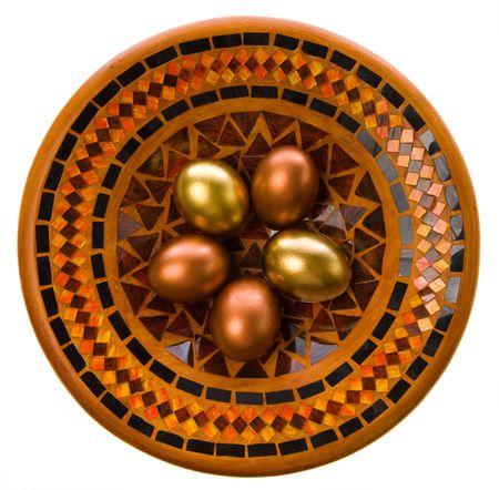 Beautiful Easter eggs lay on a celebratory dish photo