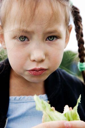 Little girl eats a sandwich  photo