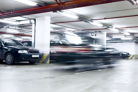 shined: The shined underground garage with the moving cars and parked cars