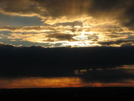 View of sunsets with heavy stormy clouds and sunbeam. photo