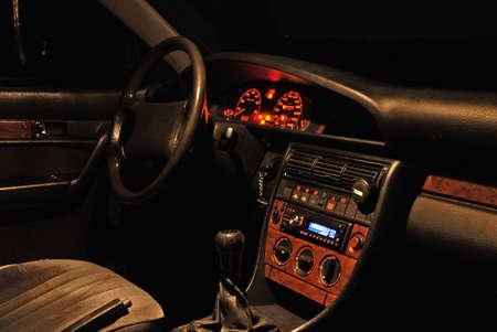 오디오: Night view of car interior from passenger seat.