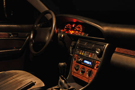 electric automobile: Night view of car interior from passenger seat.