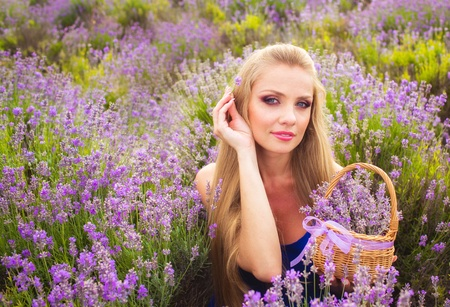 Blond girl with long hair on lavender field photo