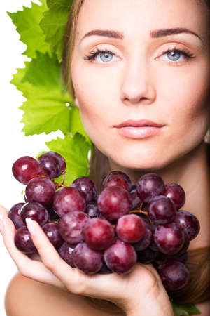 Beautiful woman with grapes foliage in hair photo