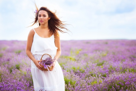 Beautiful girl with long hair on lavender field photo