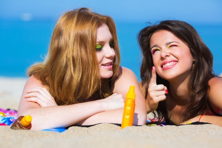 Two girlfriends on the beach photo
